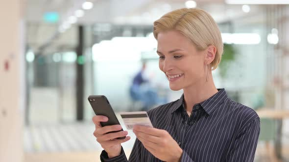 Thumbnail for Successful Online Payment on Smartphone By Businesswoman