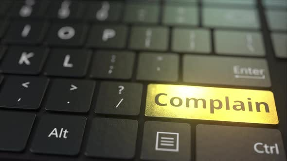 Thumbnail for Black Computer Keyboard and Gold Complain Key