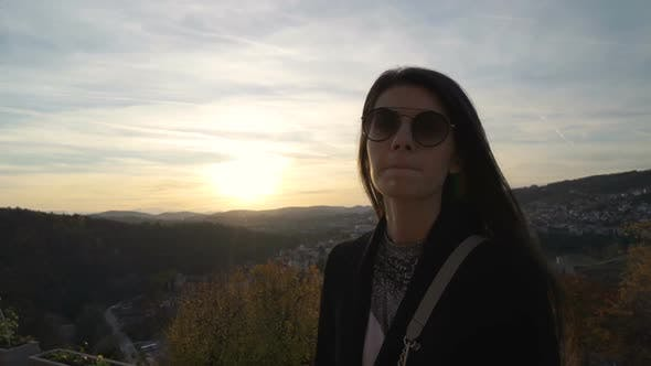 Thumbnail for Beautiful Girl Stares at Sunset Clouds Over Scenic Hills in Veliko Tarnovo, Bulgaria