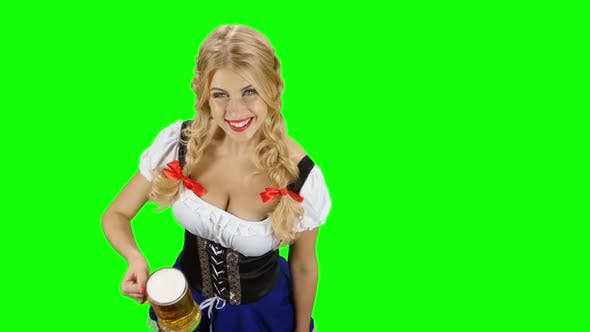 Thumbnail for Woman in Bavarian Costume Gives Someone a Beer on Oktoberfest. Green Screen
