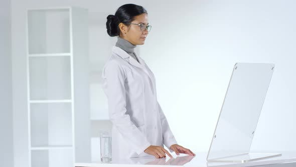Thumbnail for Female Doctor Working on Invisible Futuristic Computer