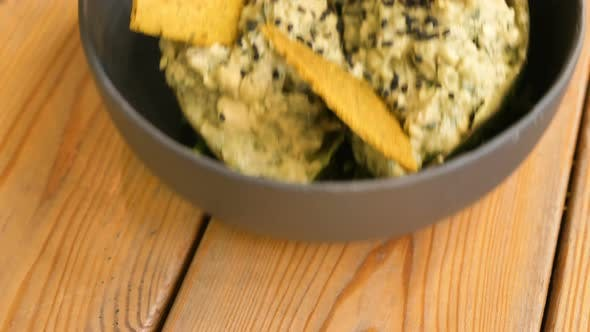 Thumbnail for Delicious Raw Food Snack with Green Leaves and Yellow Crisps