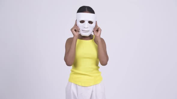 Cover Image for Happy Young African Woman Removing White Mask