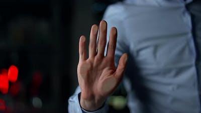 Macro of Man Handprinting on Glass Wall Indoors
