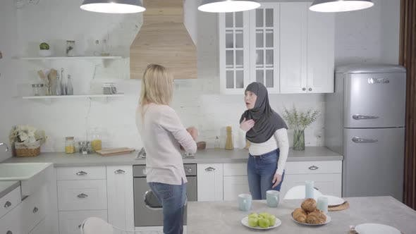 Thumbnail for Adult Caucasian and Muslim Woman Arguing at Home, Lady in Hijab Turning Back To Friend. Two Friends