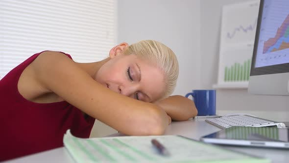 Thumbnail for Business woman resting head on desk