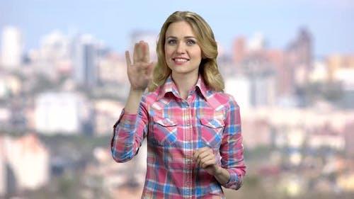 Woman Swiping Imaginary Touch Screen.