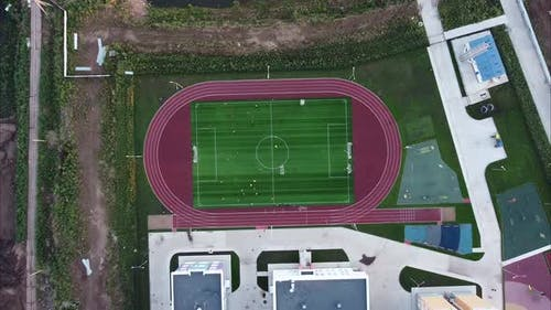 Shooting From a Height on a Football School Field in a Residential Neighborhood of Multi-storey
