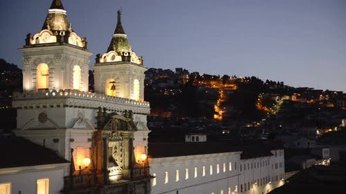 Cityscape mountain view over San Francisco church, Quito, Ecuador, at dusk