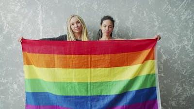 Female Lesbian Couple with LGBTQIA Pride Flag