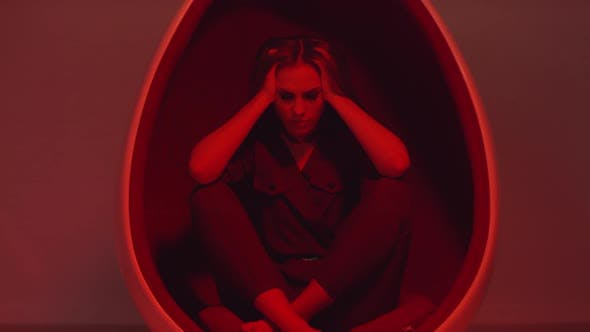 Thumbnail for Angry Woman Posing with Head in Her Hands under Red Light