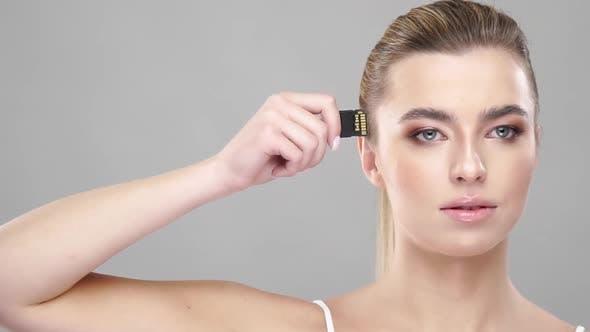 Thumbnail for Beautiful Woman Holding Micro Sd Card Near Her Head