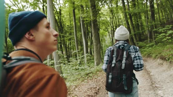 Thumbnail for Backpacked Tourists Walking in Forest Backview