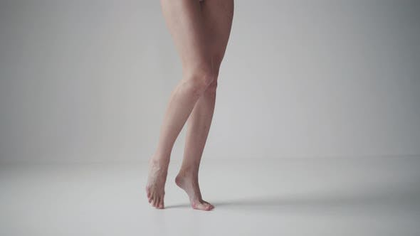 Thumbnail for Girl Standing on Tiptoes Barefoot. Female Legs Close Up