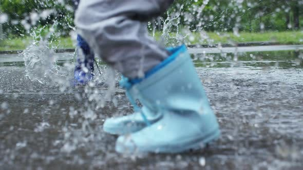 Thumbnail for Children Jumping in Puddle