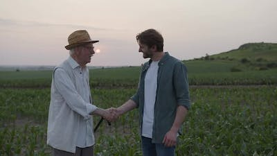 Two Farmers Shake Their Hands Together