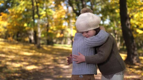 Thumbnail for Cute Boy Hugging Sister with Down Syndrome Outdoor
