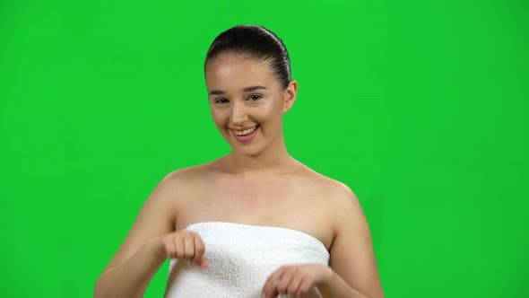 Thumbnail for Cute Girl Smiles and Showing Heart with Fingers Then Blowing Kiss on Green Screen at Studio