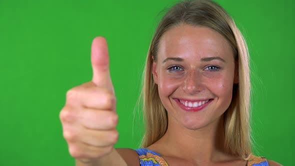 Thumbnail for Young Pretty Blond Woman Shows Thumb Up on Agreement - Green Screen - Studio