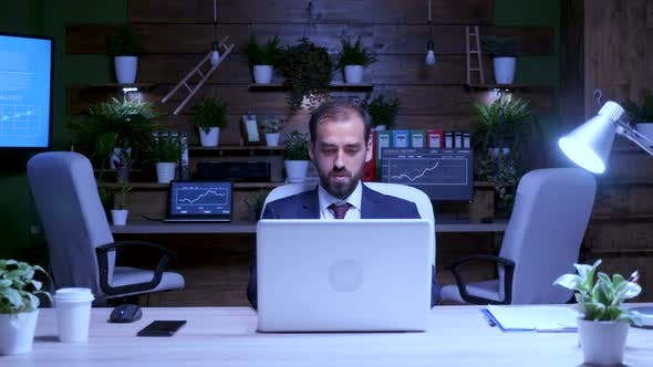 Zoom in Shot of Businessman Working on the Computer