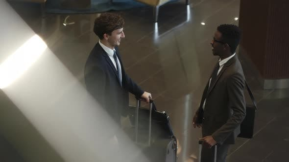 Thumbnail for Business Partners Greeting Each Other in Hotel Lobby