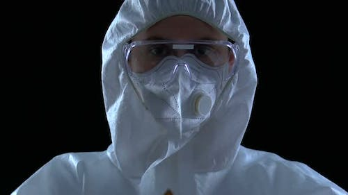 Scientist in Uniform Showing Inflammable Sign to Camera, Destructive Substances
