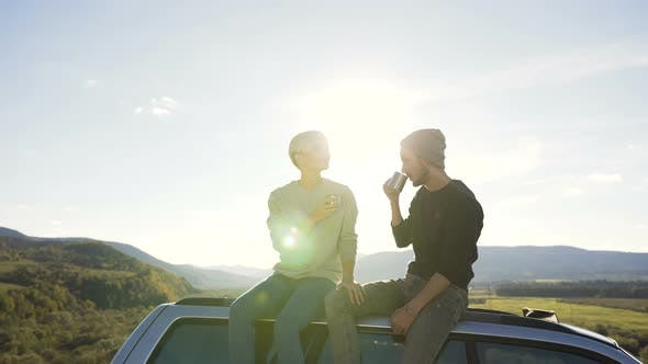 Thumbnail for Dolly Shot of Beautiful Couple Relaxing in the Mountain with Cup of Tea.