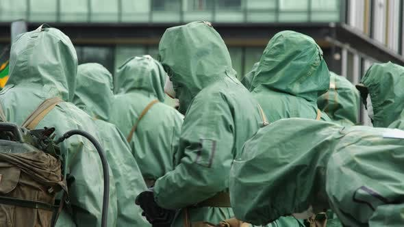 Thumbnail for People in Bio Viral Hazard Protective Suits. Disinfection and Decontamination on a Public Place As a