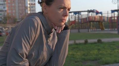 Sad Woman on Playground.