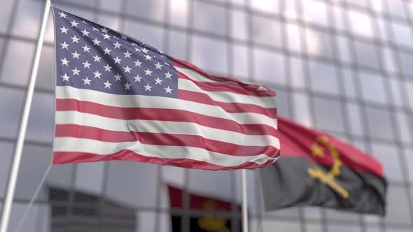 Thumbnail for Flags of the United States and Angola in Front of a Skyscraper