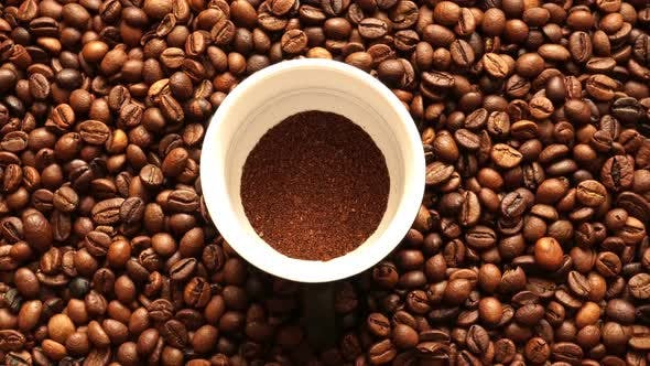 Thumbnail for Ground Coffee On The Background Of Grilled Coffee Greens