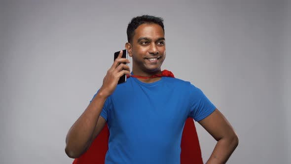 Thumbnail for Indian Man in Superhero Cape Calling on Smartphone