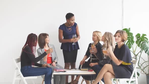 Thumbnail for Portrait of Female Business Team in Modern Studio with Glasses of Champagne