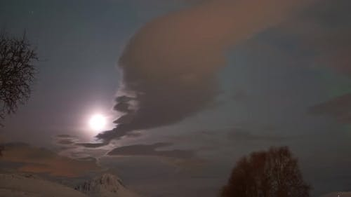 The moon, the clouds and the Northern Lights near Tromso, Norway, Arctic
