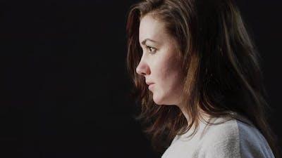 Sad woman sighing