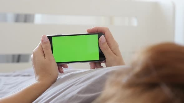 Thumbnail for Female holds greenscreen display tablet  in bedroom  4K 2160p 30fps UltraHD video - Woman at home wi