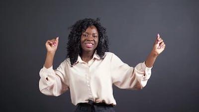 Positive AfricanAmerican Woman with Headphones Dances