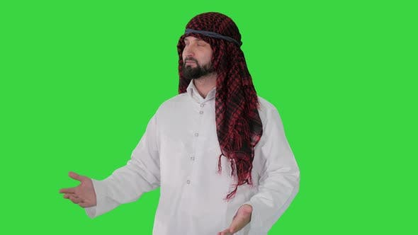 Thumbnail for Sheikh Wearing Keffiyeh Doing Welcome Gesture on a Green Screen, Chroma Key