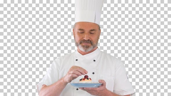 Chef putting cherry on top of the cake, Alpha Channel