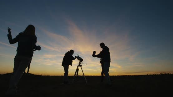 Thumbnail for Friends Stargazing Together Using a Professional Telescope