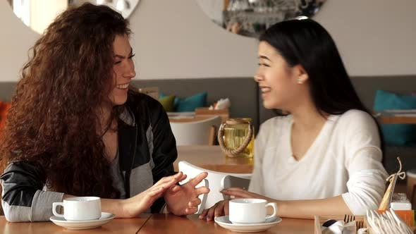 Thumbnail for Girl Tells Something Funny To Her Friend