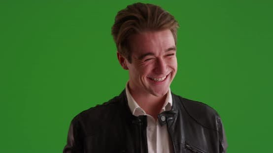 Thumbnail for Male in leather jacket winking at camera on green screen