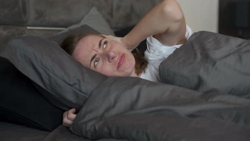 Tired Woman Can't Sleep
