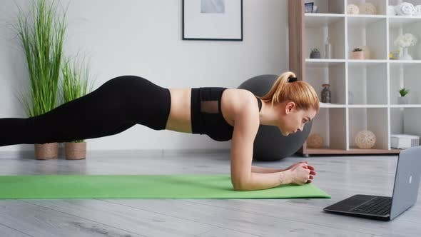 Fitness at Home Pilates Online Woman Holding Plank
