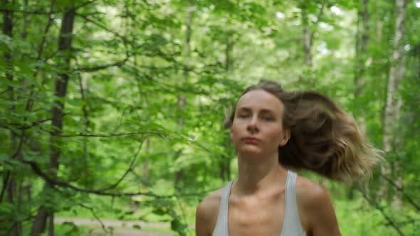 Thumbnail for Young Female Athlete Running Through the Woods