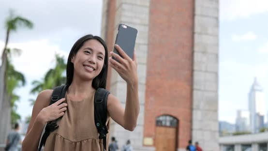 Thumbnail for Woman travel in Hong Kong and talking on video call with cellphone in Hong Kong