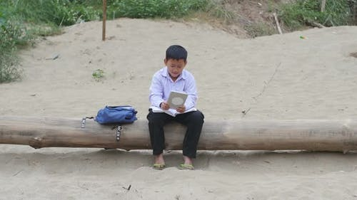Boy Plays On iPad