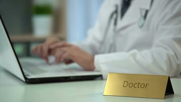 Thumbnail for Doctor Typing Diagnosis on Laptop, Keeping Medical Records, Consultation