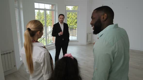 Thumbnail for Positive Family Looking Around New House for Sale