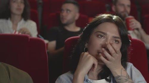 Woman Watching Drama in Cinema